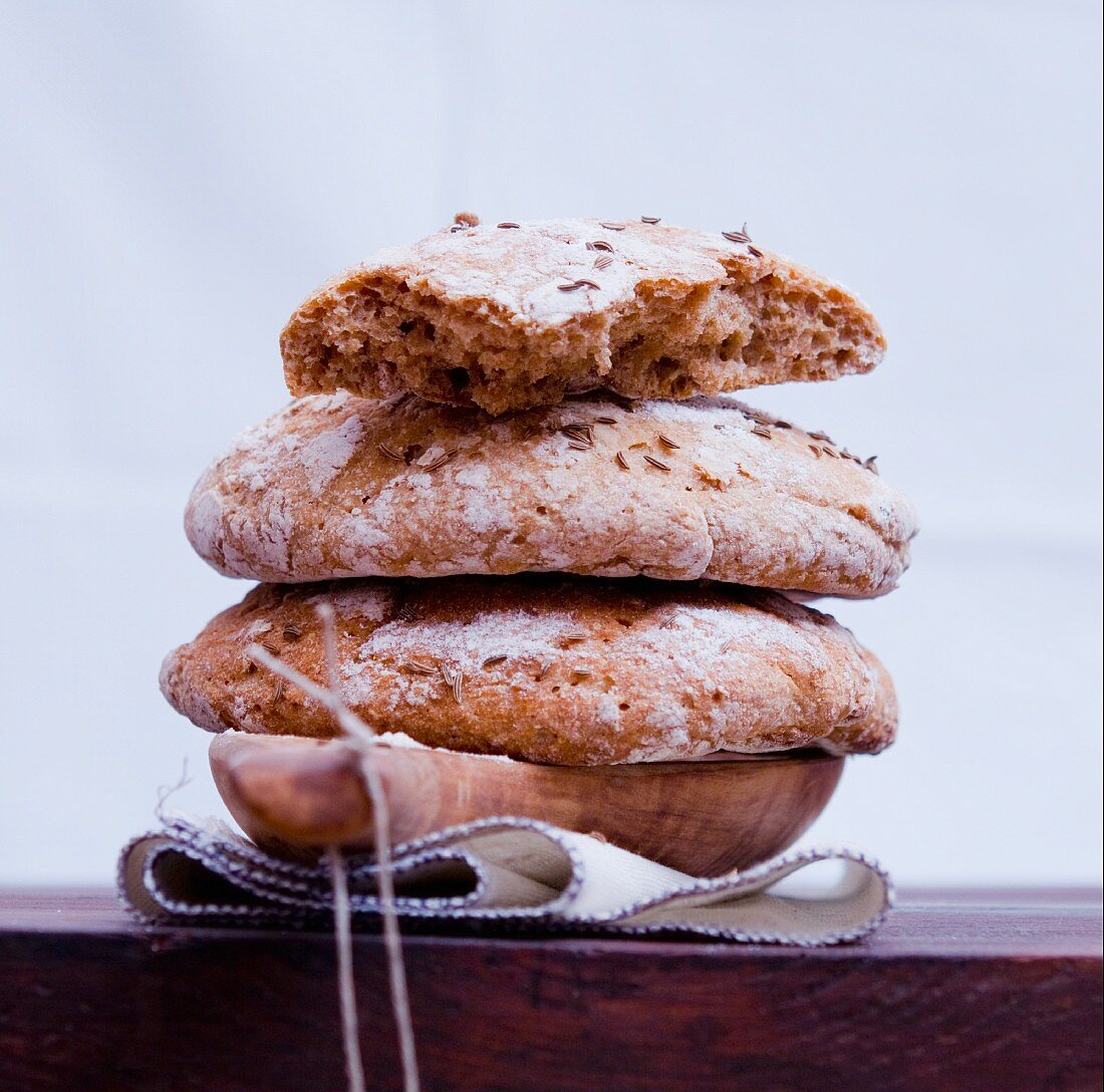 A stack of Vinschgauer bread (rye-wheat sour dough) with caraway