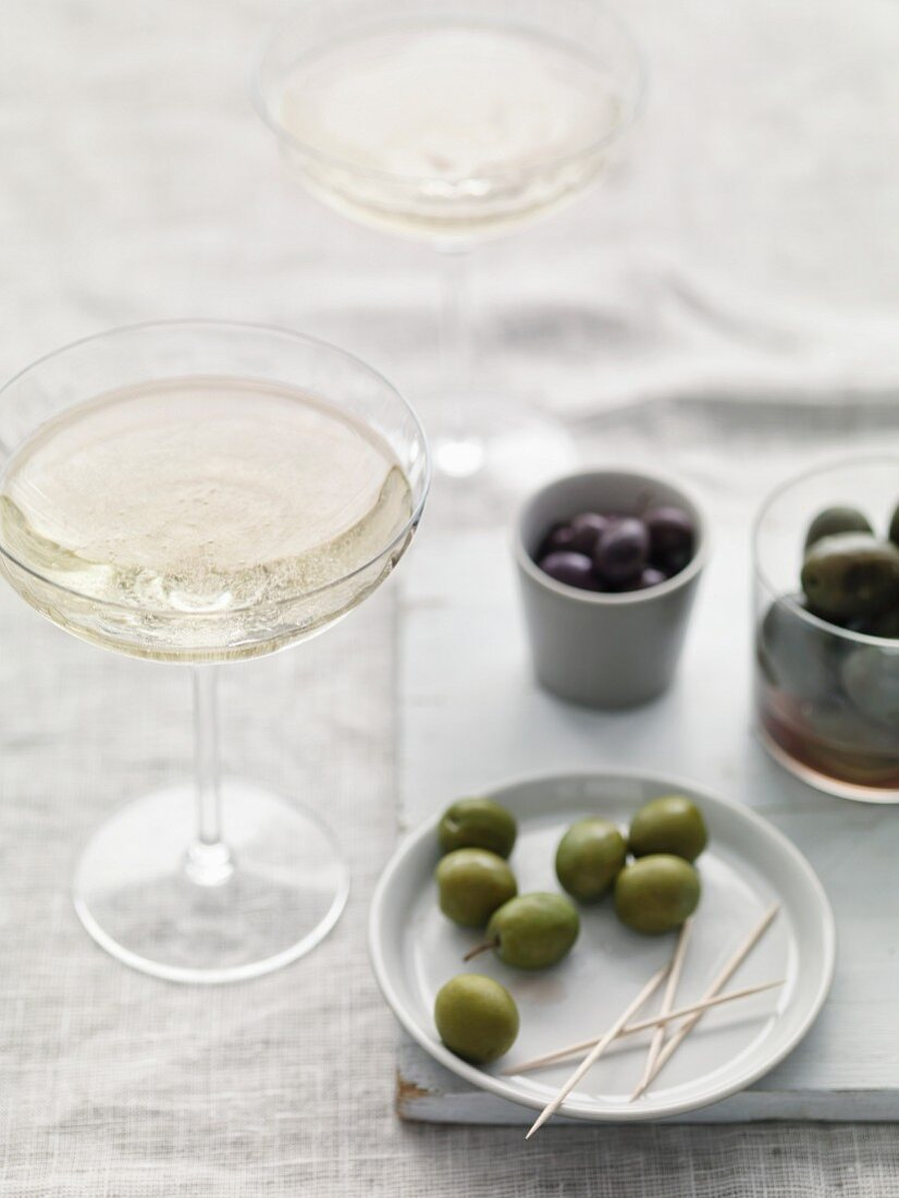 Assorted olives and sparkling wine