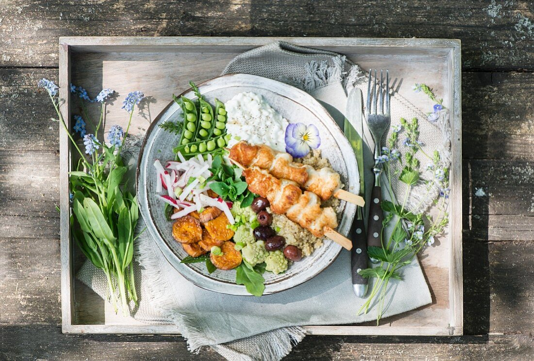 Chicken kebabs with peas, sweet potato and radish salad and cottage cheese