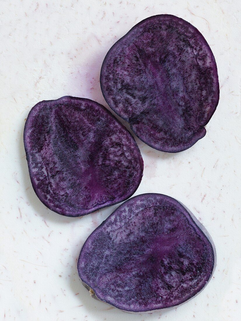 Halved purple potatoes (seen from above)