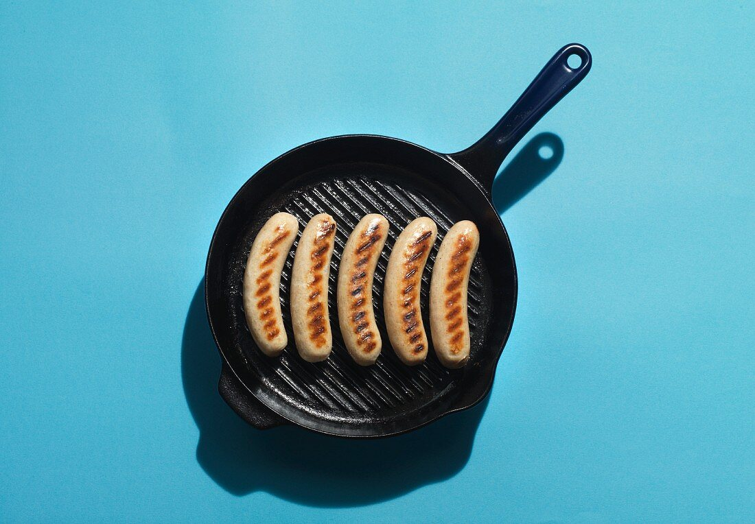 Sausages in a griddle pan