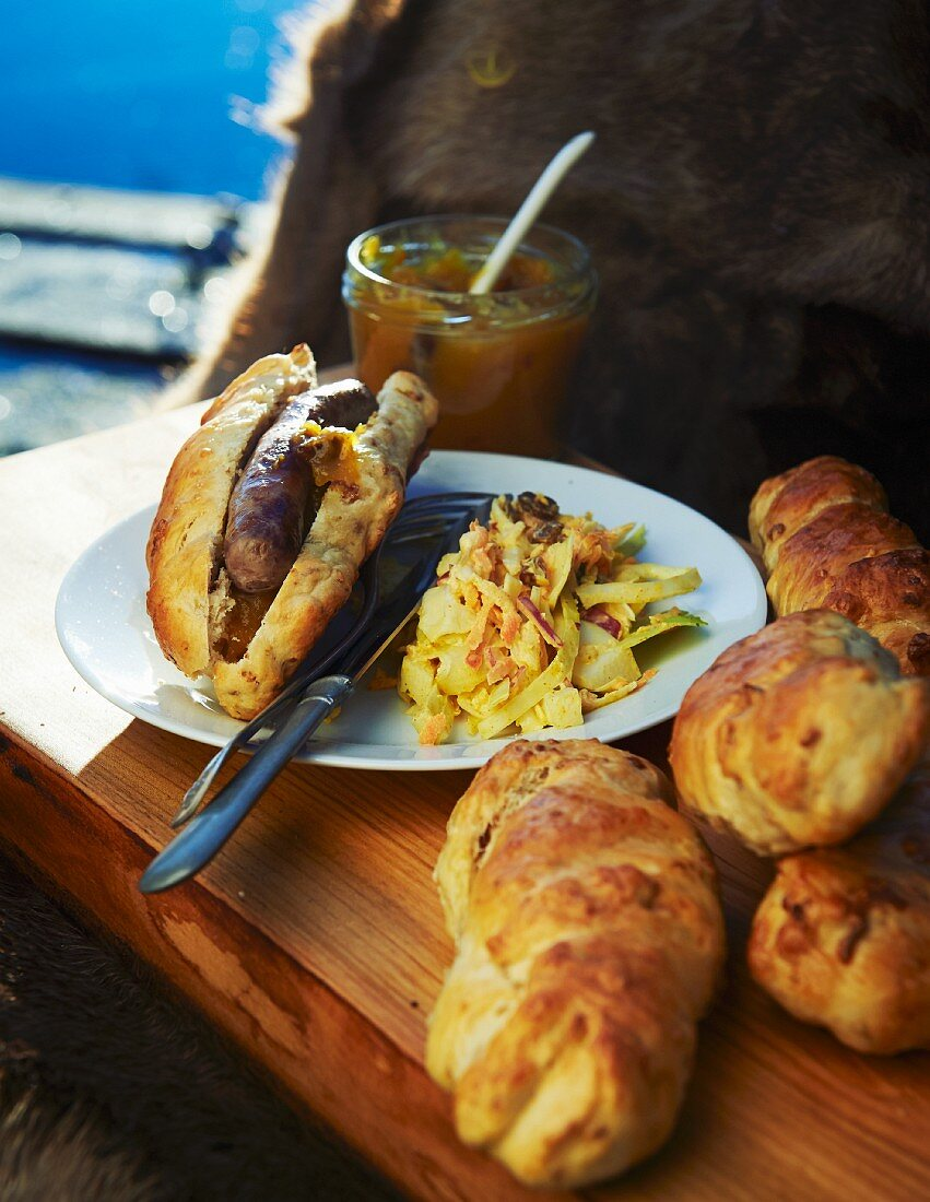 Hot dog buns with grilled wild boar sausage and coleslaw