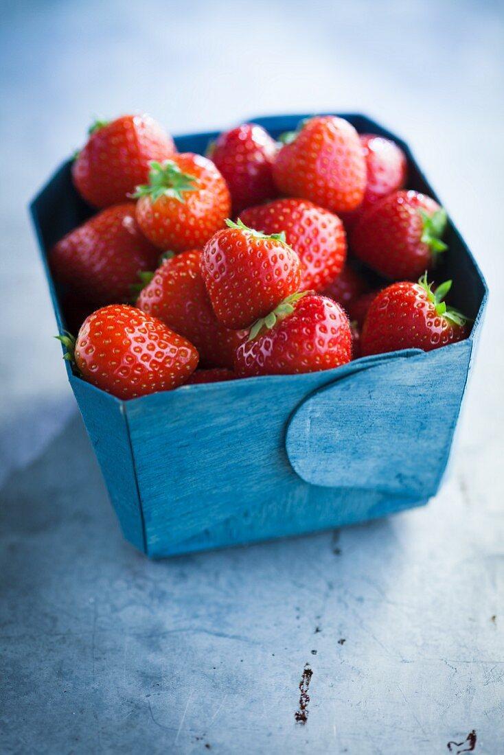 Strawberries in a blue cardboard box