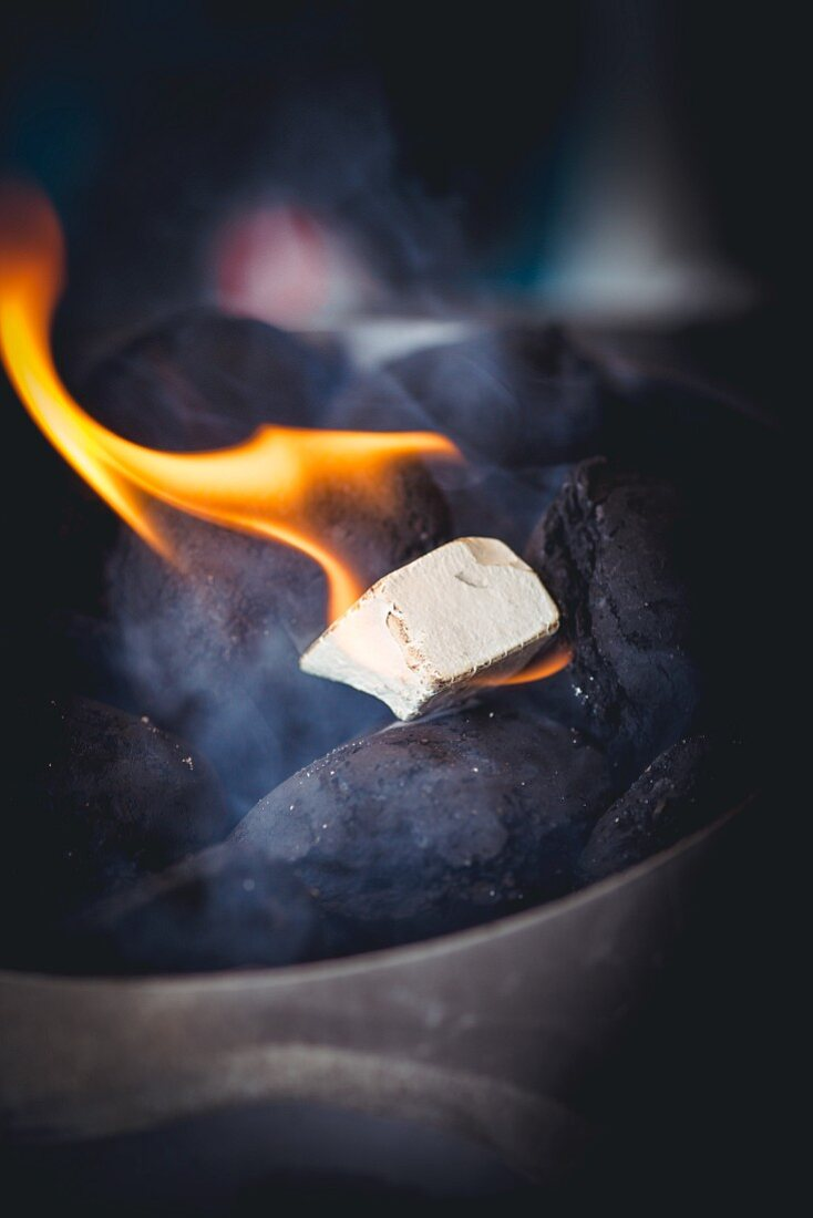A burning barbecue lighter