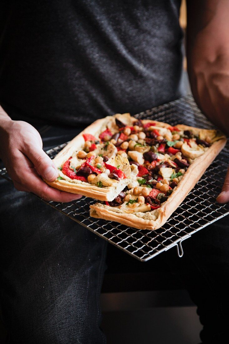 A vegan artichoke tart with chickpeas and olives