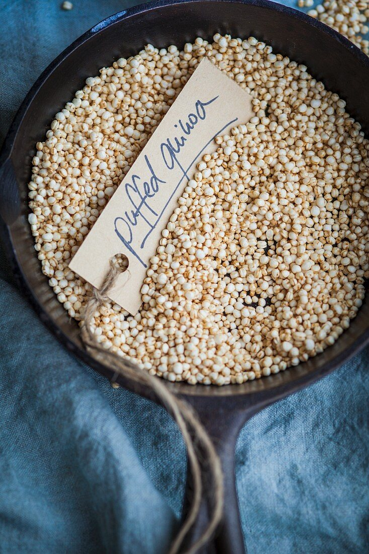 Puffed quinoa in a small dish (top view)