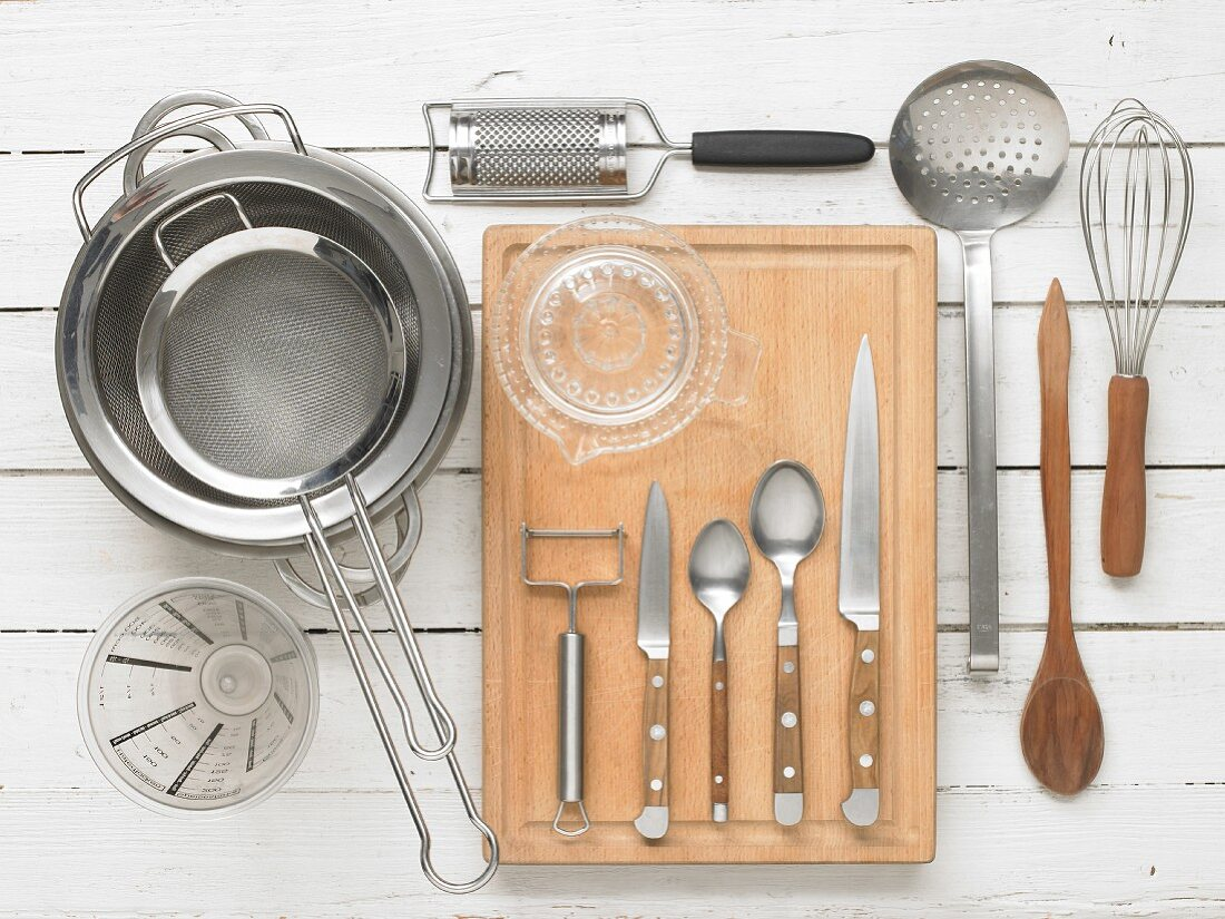 Kitchen utensils for preparing tagliatelle with asparagus and Grisons air-dried beef