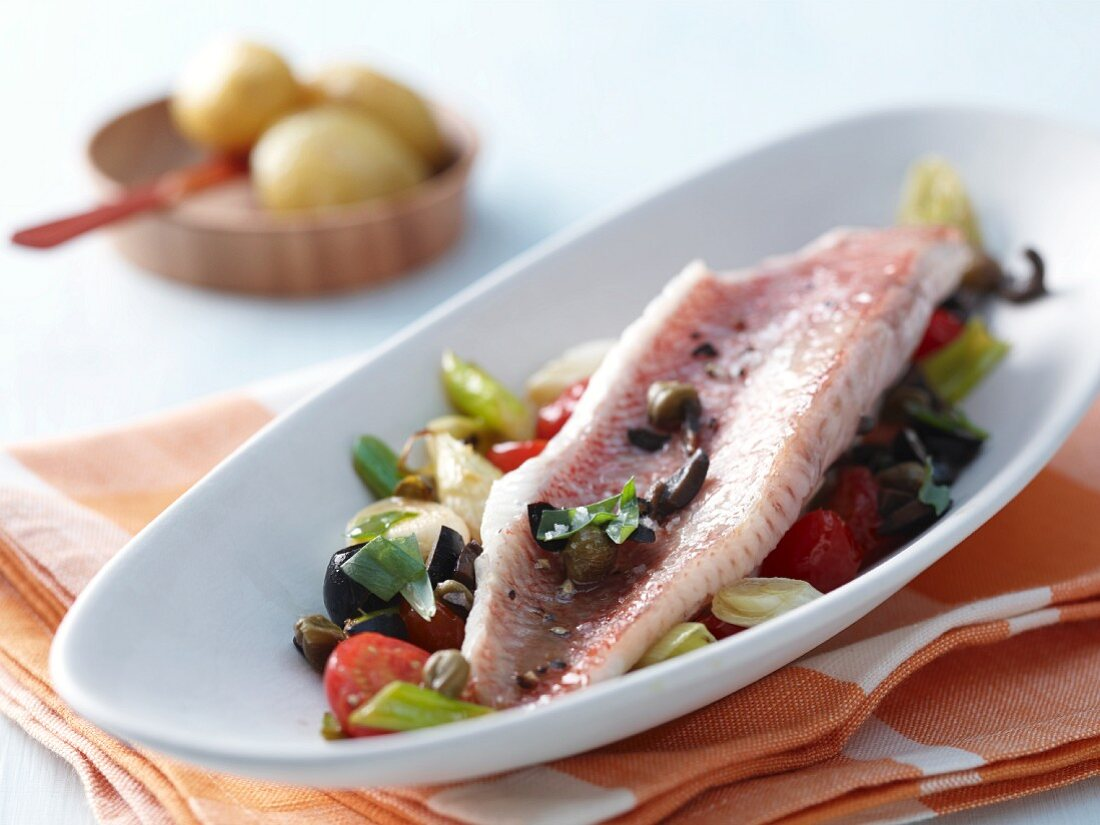 Fillet of rose fish with cherry tomatoes and olive and tarragon sauce