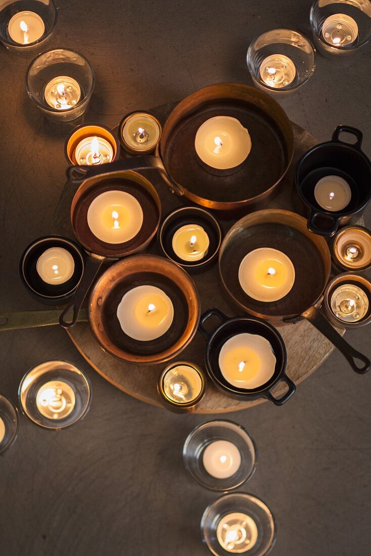 Candles in pots and glasses (top view)