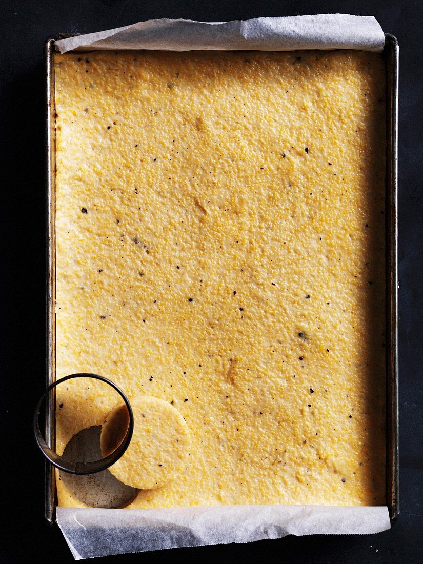 Polenta with a cutter on a baking tray