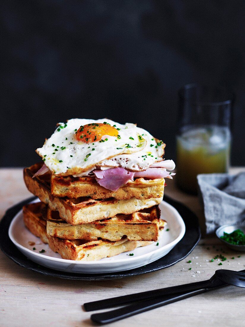 Polenta & cheese waffles with ham and fried eg