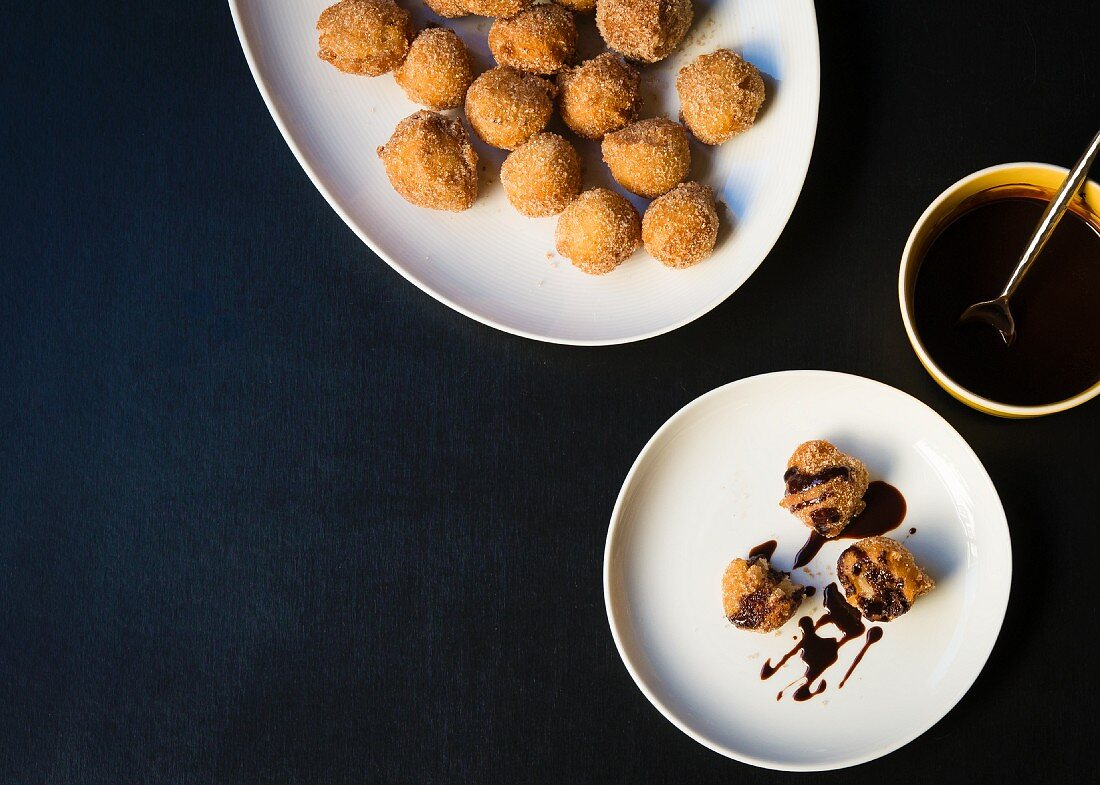 Banana beignets with chocolate sauce (seen from above)