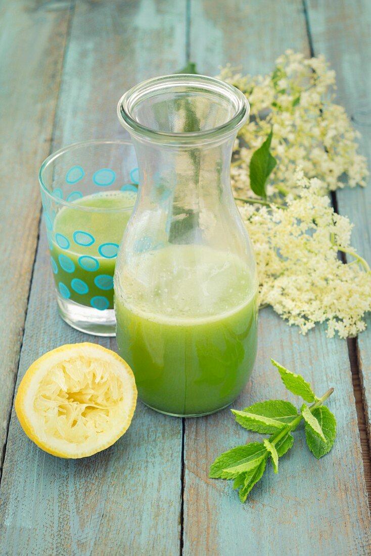 Detox cucumber lemonade with elderflower syrup and mint