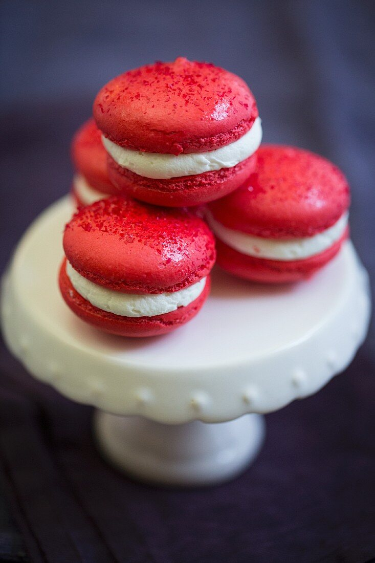 Red macarons for Valentine's Day on a porcelain cake stand