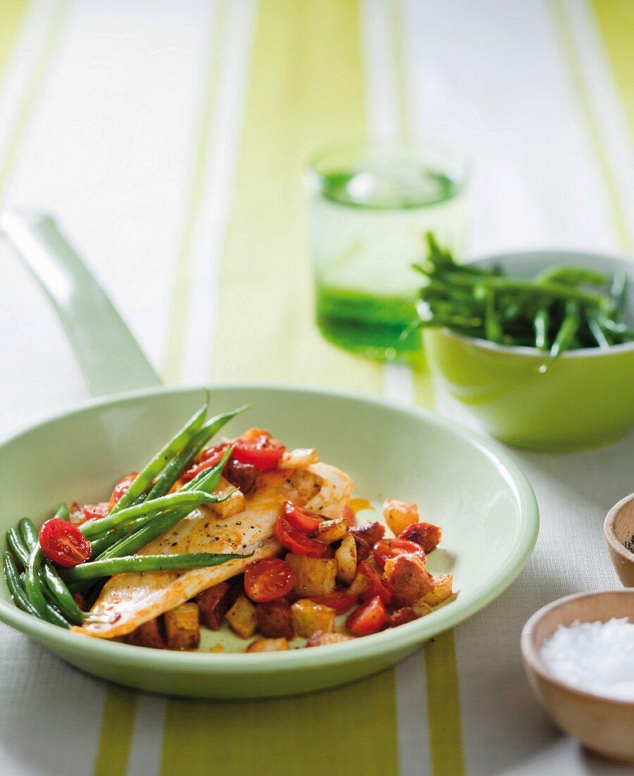 Hake with chorizo, potatoes, tomatoes and green beans