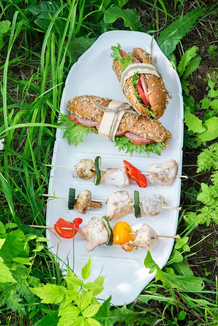 Chicken & vegetable kebabs with salami sandwiches for a picnic