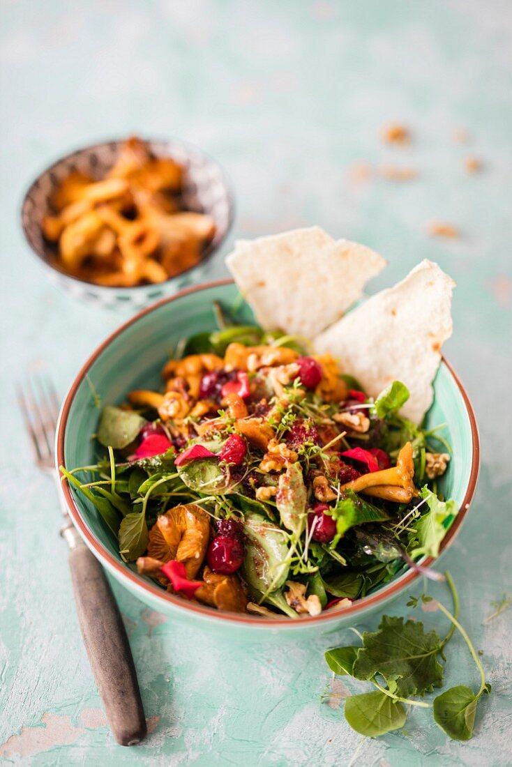 Wild herb salad with chanterelle mushrooms