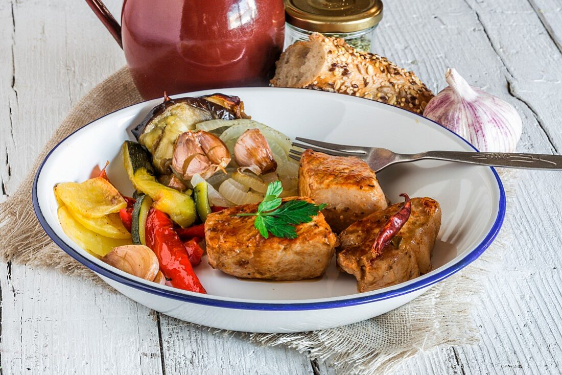 Pork medallions with parsley and vegetables served with a multi-grain baguette