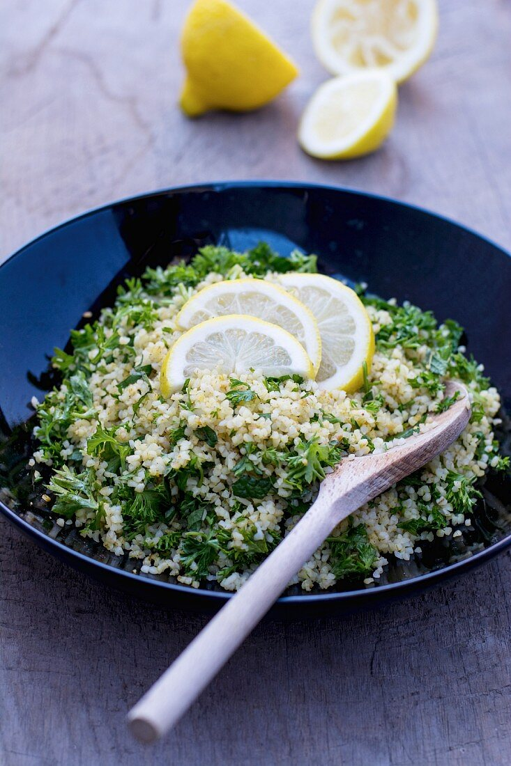 Parsley & bulgar wheat salad with slices of lemon