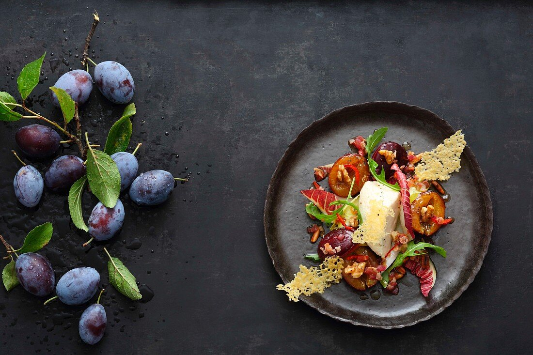 Caramelised plums with Parmesan mousse and radicchio & rocket salad