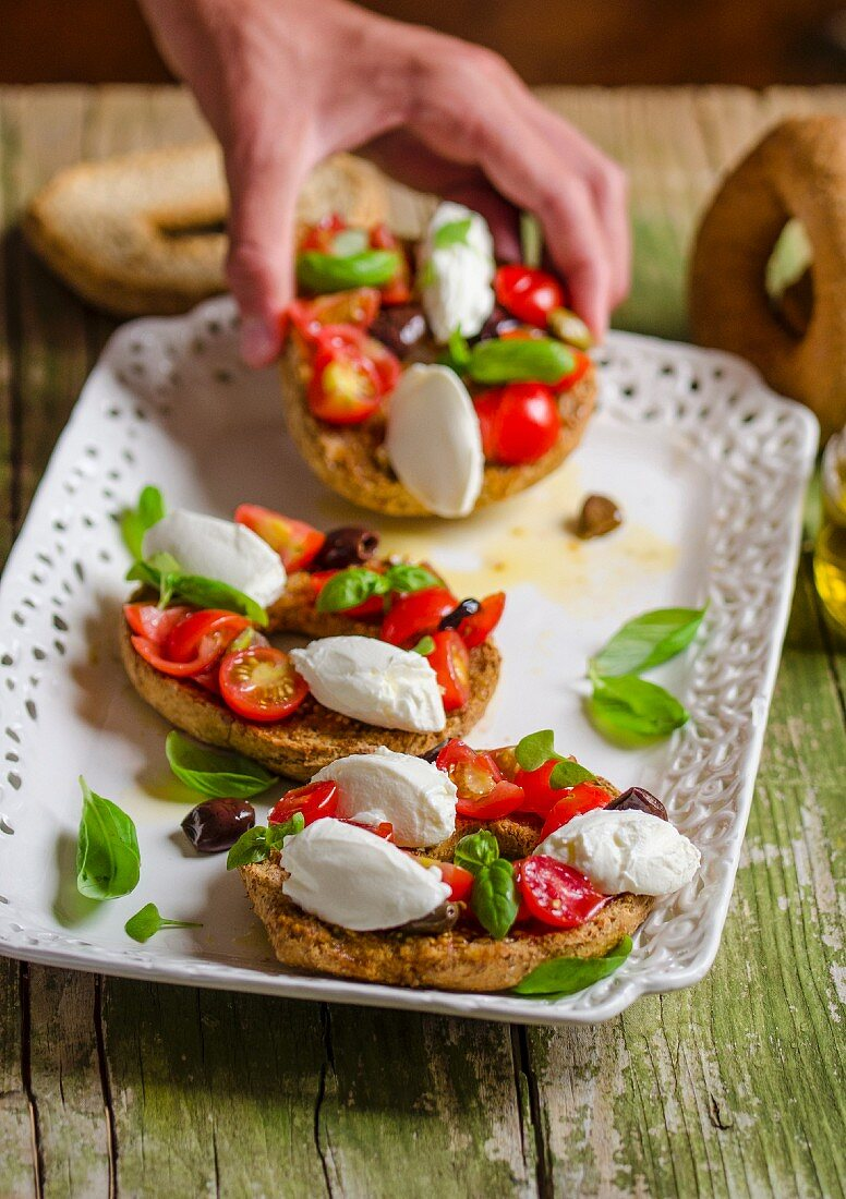 Friselle with cherry tomatoes, basil and cream cheese