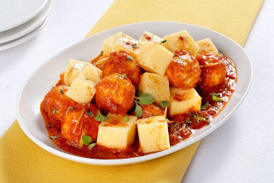 Polenta cubes with chicken meatballs
