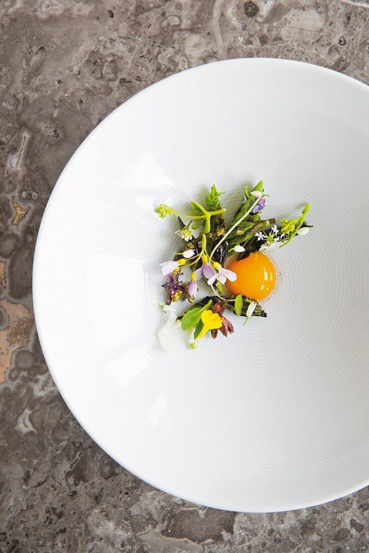 A quail egg with wild herbs at the restaurant Geranium in Copenhagen, Denmark
