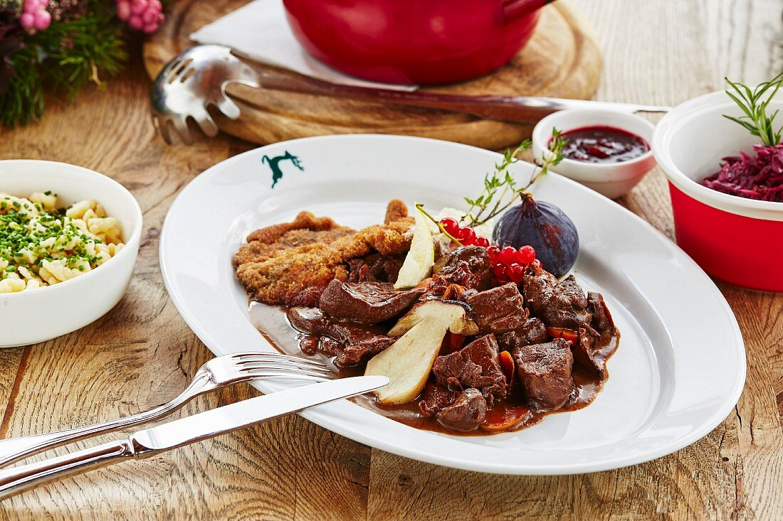 Vension goulash and venison escalope in breadcrumbs with porcini mushrooms, red cabbage and Spätzle (soft egg noodles)
