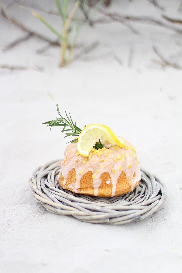 Lemon Bundt cake on a sandy beach