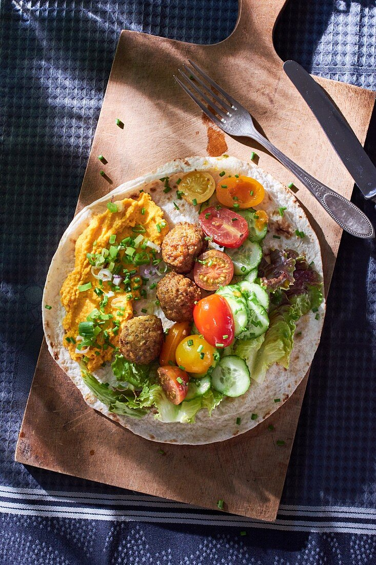Falafel with vegetables on pitta bread