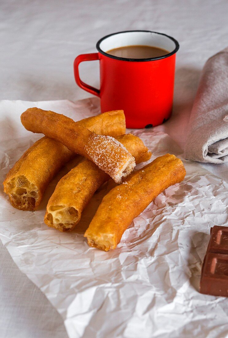 Churros and coffee on creased paper