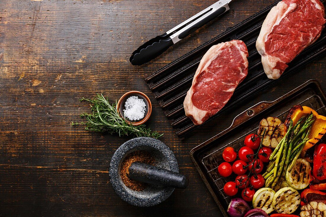 Raw fresh meat Steak Striploin and Grilled vegetables