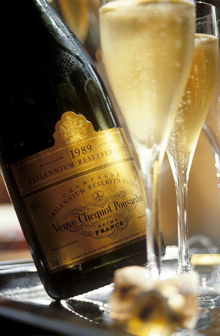 """Glass beside Veuve-Cliquot """"Millennium Champagne"""""""