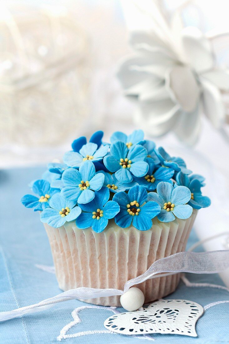 Cupcake decorated with sugar forget-me-nots
