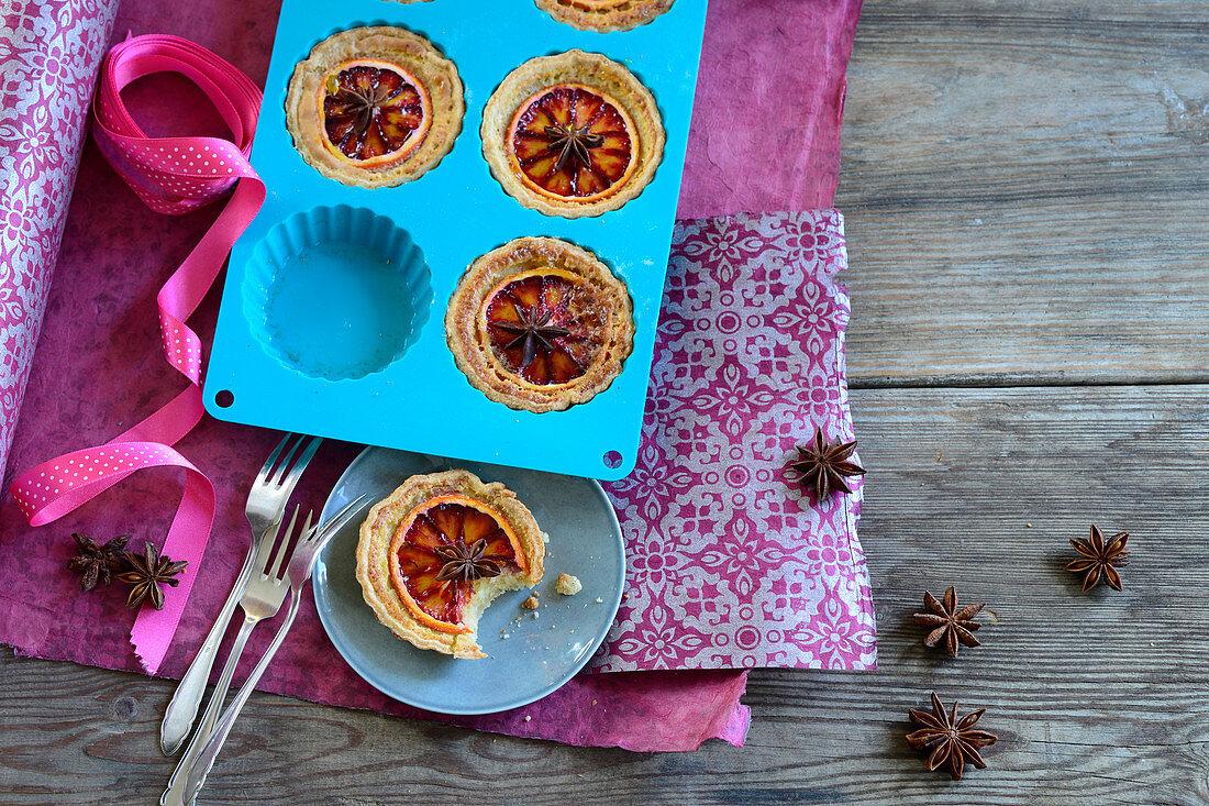 Orange tartlets with star anise