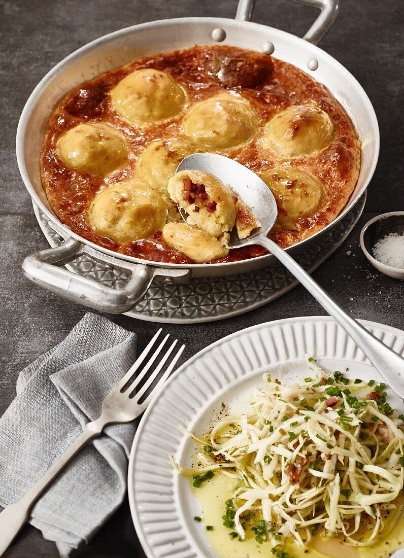 Baked bacon dumplings with a bacon and cabbage salad