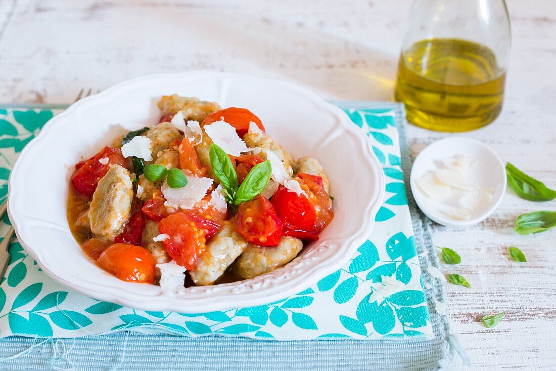 Aubergine gnocchi with fresh tomatoes and basil