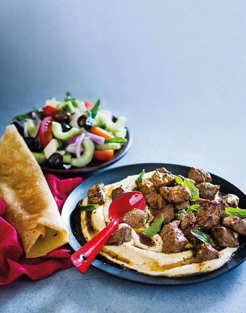 Dosas with lamb, hummus and Greek salad