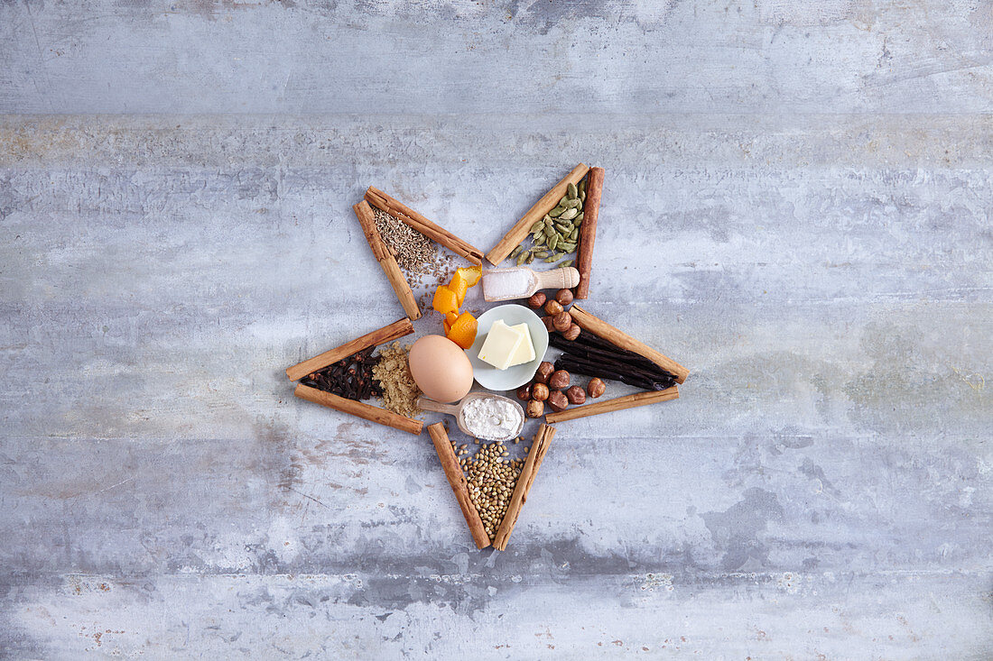 Christmas ingredients and spices arranged in a star shape