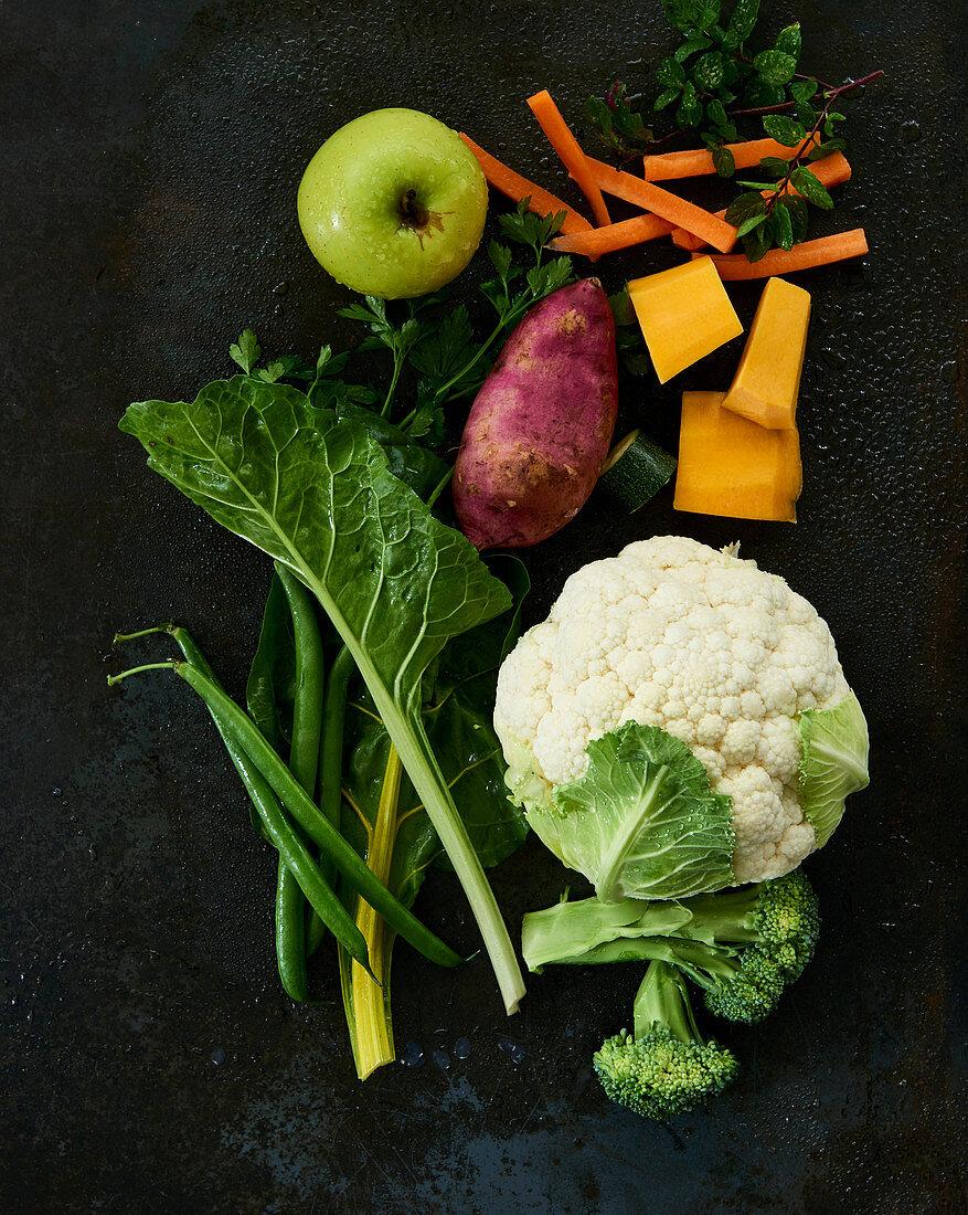 An arrangement of vegetables and fruit (ingredients for dog food)