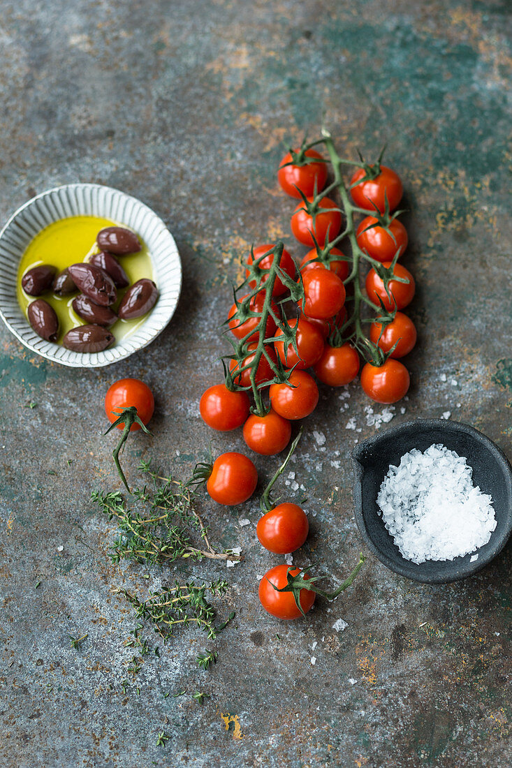 Cherry tomatoes, olives, salt and fresh thyme