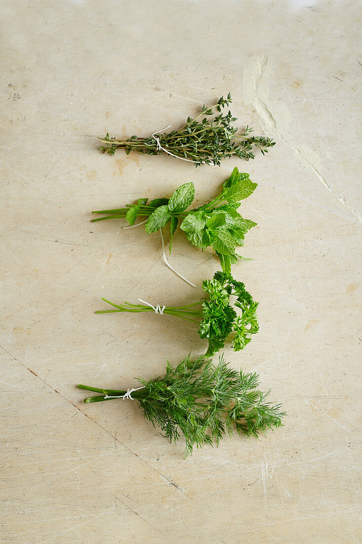Four bouquets of herbs (seen from above)