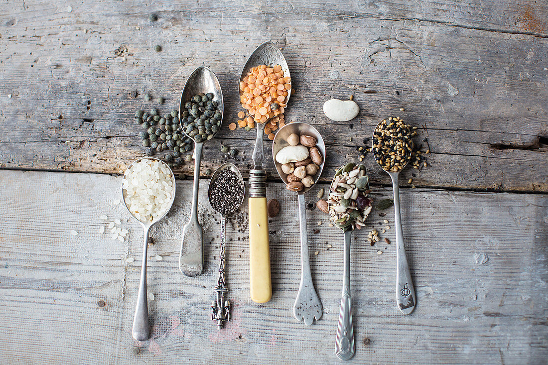 Rice, pulses, seeds and kernels on spoons