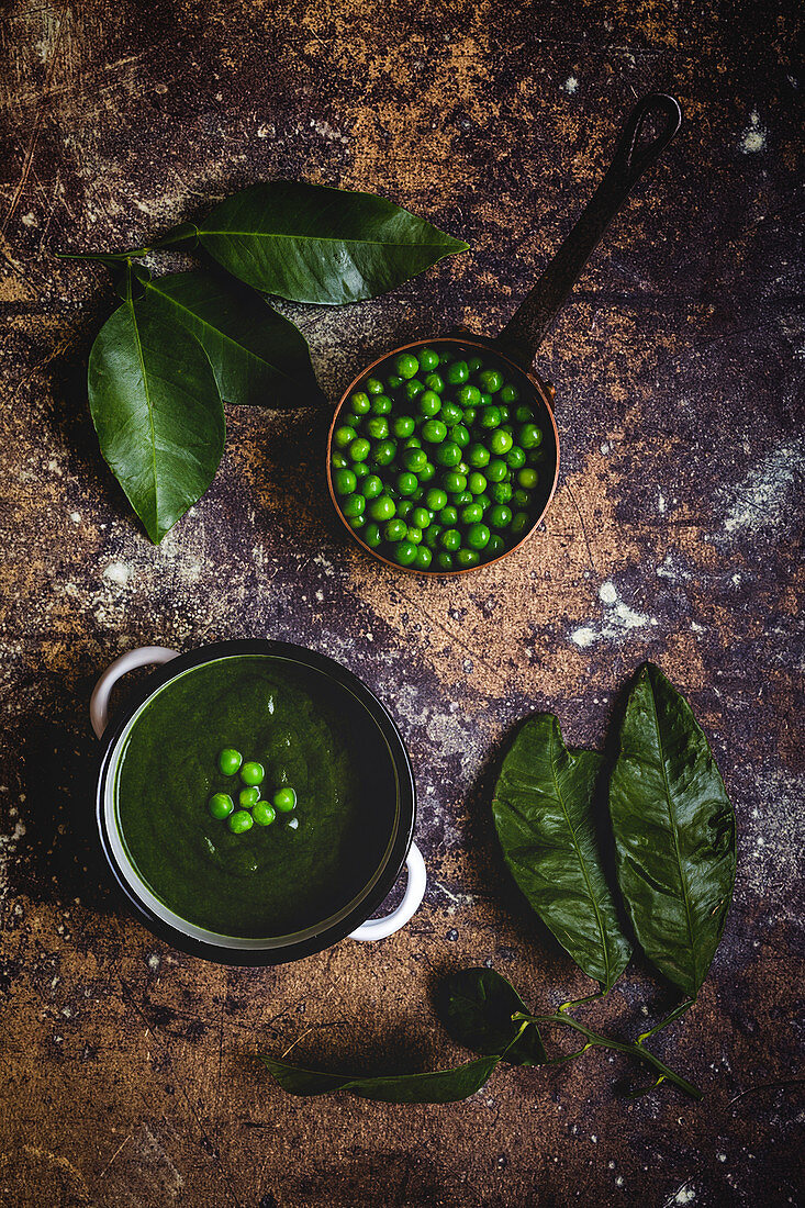 Creamy green vegetable soup with peas and beans