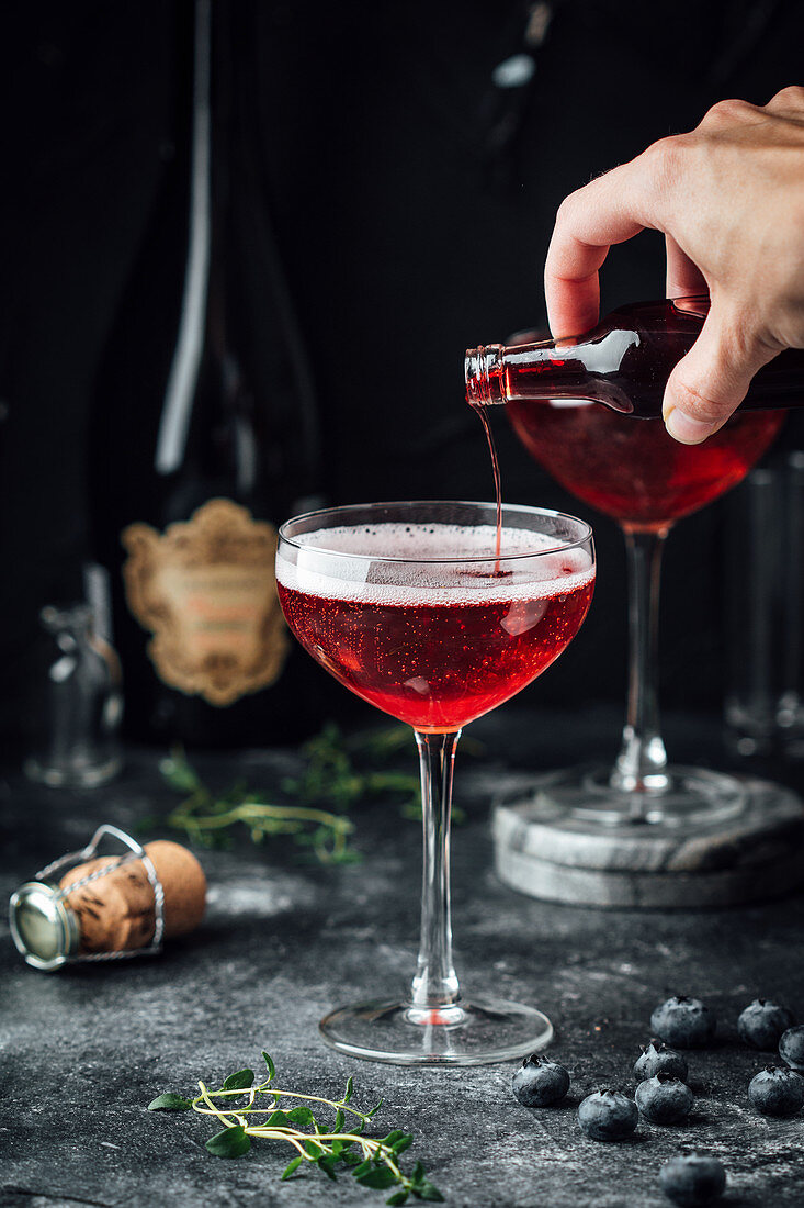 Strawberry prosecco with blueberries and thyme