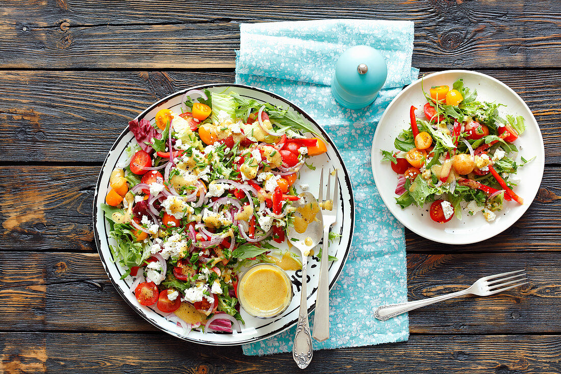 A colourful salad with feta and mustard dressing