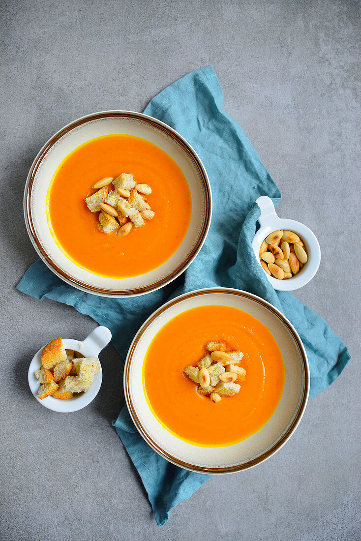 Pumpkin soup served with croutons and almonds