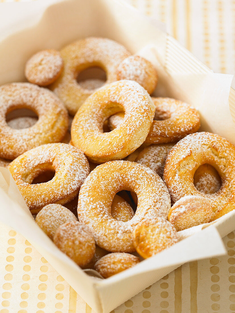 Donuts with powdered sugar in a box