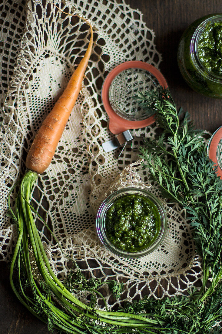 Jars of carrot and wild garlic pesto on a lace doily