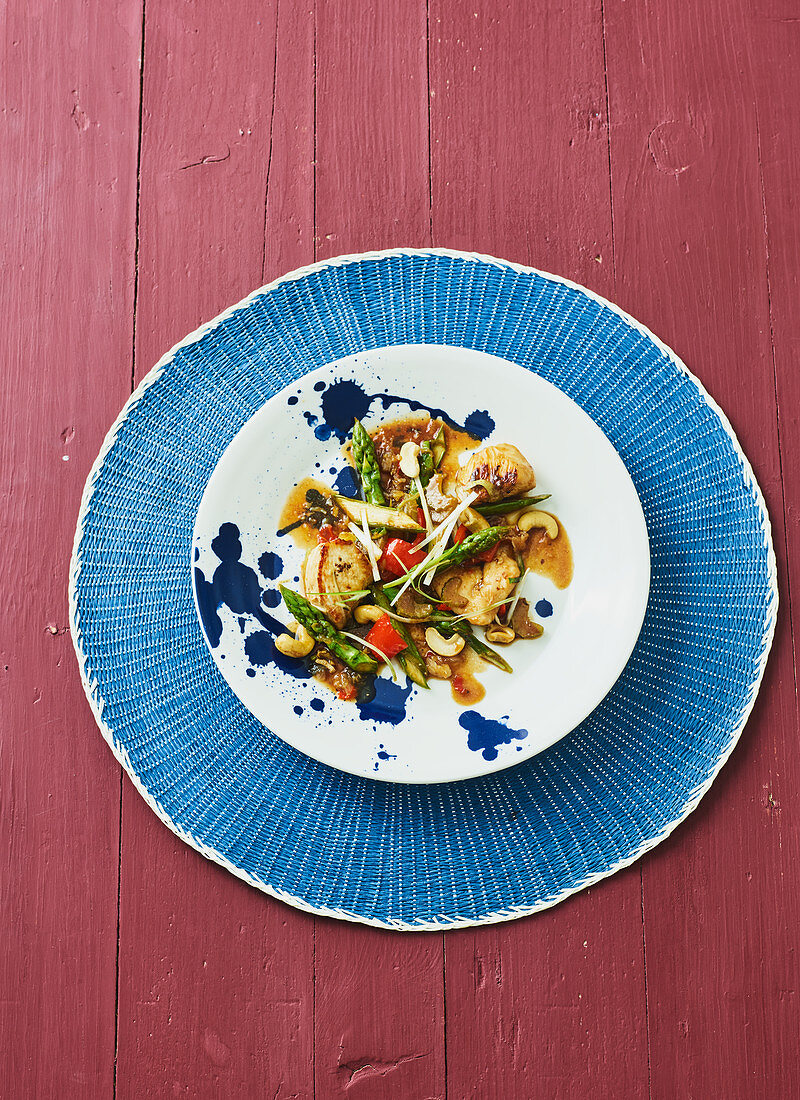 Pan-fried chicken with green asparagus (Singapore)